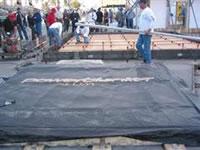 Curing concrete with heated blankets